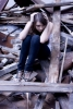 scared-girl-sits-on-ruins-1348272-s